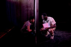 Khalid (Antonio Khela) confronted by guard, Wade (Edward Nkom). Guantanamo Boy. Photo by Camilla Greenwell