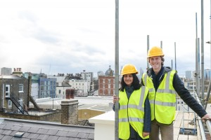 Chris Elwell on the roof at Half Moon Theatre, White Horse Road, during renovations