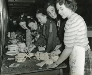 Brownies making sandwiches, 1951. Image courtesy of the Tower Hamlets Local History Library and Archives.