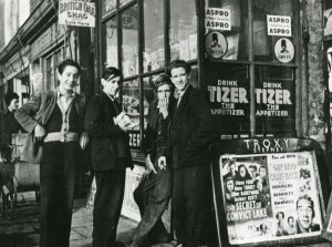 Teenagers with Troxy advertising board, 1950s. Image courtesy of the Tower Hamlets Local History Library and Archives.