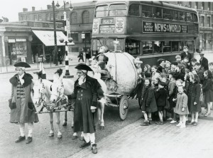 Children gather around Cinderella's coach in an event to advertise the film at the Troxy, 1950s. Image courtesy of the Tower Hamlets Local History Library and Archives.