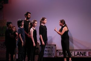 Equinox Youth Theatre performing A Stroll Down Memory Brick Lane, part of Playful Heritage