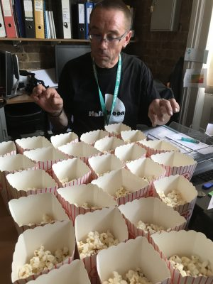 Production Manager Phil Clark surveying the popcorn used in Solar Youth Theatre's Rock Around the Clock