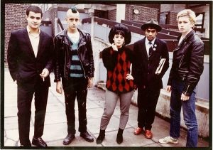 Punjabi Punk. Suresh Singh, in the hat, with punk friends in Spitalfields, 1977. Photograph courtesy of Jagir Kaur.