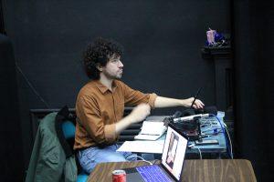 Rehearsal photo of composer Adam from Hot Orange ensemble