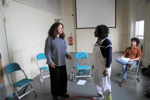 Rehearsal photo of spoken word artists, Tatenda, Amal and Adam from Hot Orange ensemble