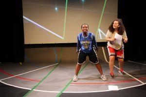 Production photo of Tatenda and Amal from Hot Orange ensemble