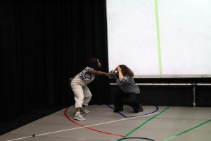 Rehearsal photo of Tatenda and Amal from Hot Orange ensemble.