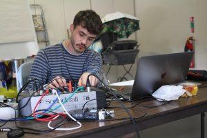 Rehearsal photo of sound designer Jake for LOOPINDOORS