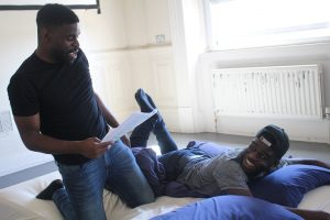 Rehearsal photo of actors John and Kenneth for 10-In-The-Bed