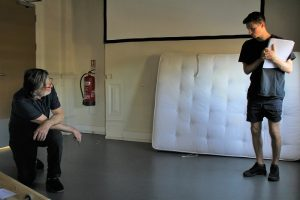 Rehearsal photo of actors, Michael and Peter for The Bench