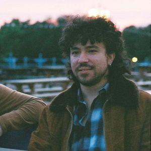 Headshot of composer Adam Paroussos