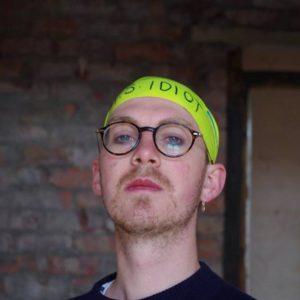 Headshot of spoken word artist Tom Stokley