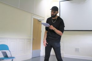 Rehearsal photo of spoken word artist Zohab for Boys will be boys.