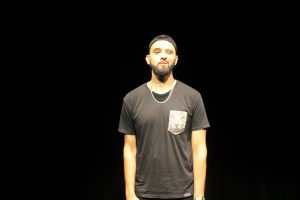 Production photo of spoken word artist Zohab for Boys will be boys.